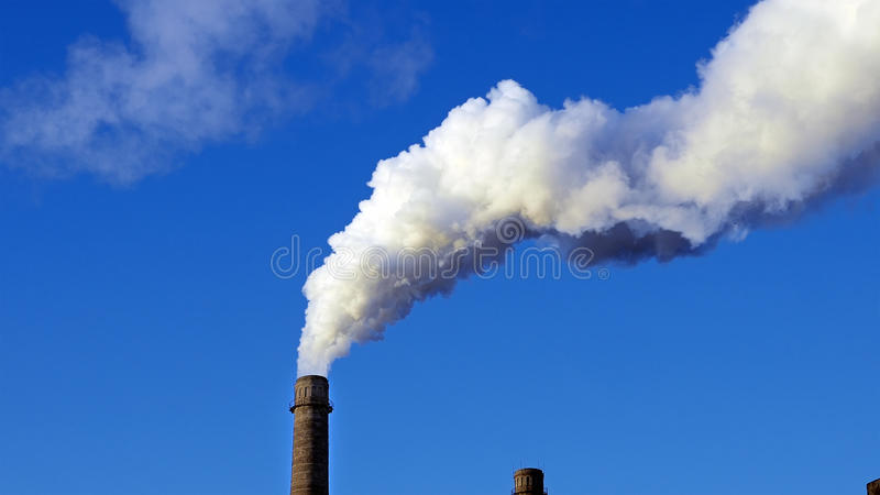 Factory plant smoke stack over blue sky background. Energy generation and air environment pollution industrial scene royalty free stock photos