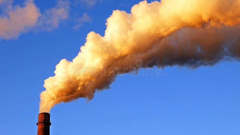 Factory plant smoke stack over blue sky background. Energy generation and air environment pollution industrial scene stock image