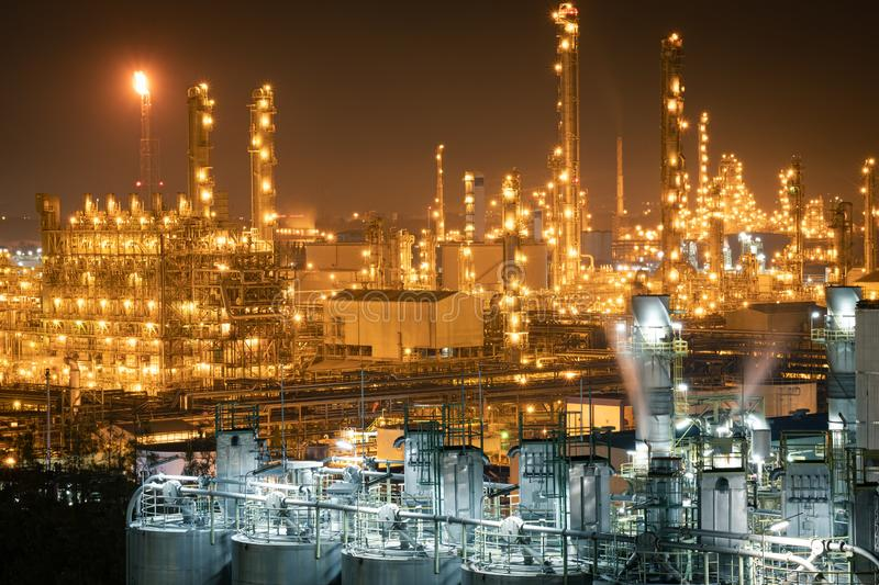 Factory of power and energy industrial at night. Petrochemical plant at twilight. Factory of power and energy industrial at night.power plant at night stock image