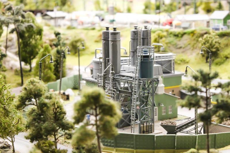The factory processes is located in the middle of the forest stock photos