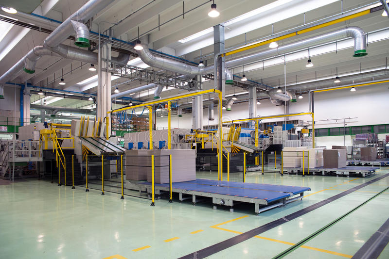 Factory - Production of cardboard foodstuff containers. Automatic machines for the production and printing of cardboard foodstuff containers (mainly pizza boxes royalty free stock photos
