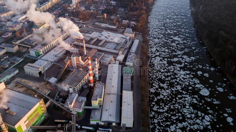 Factory in the rays of the rising sun. bird`s eye view. environmental pollution.  stock images