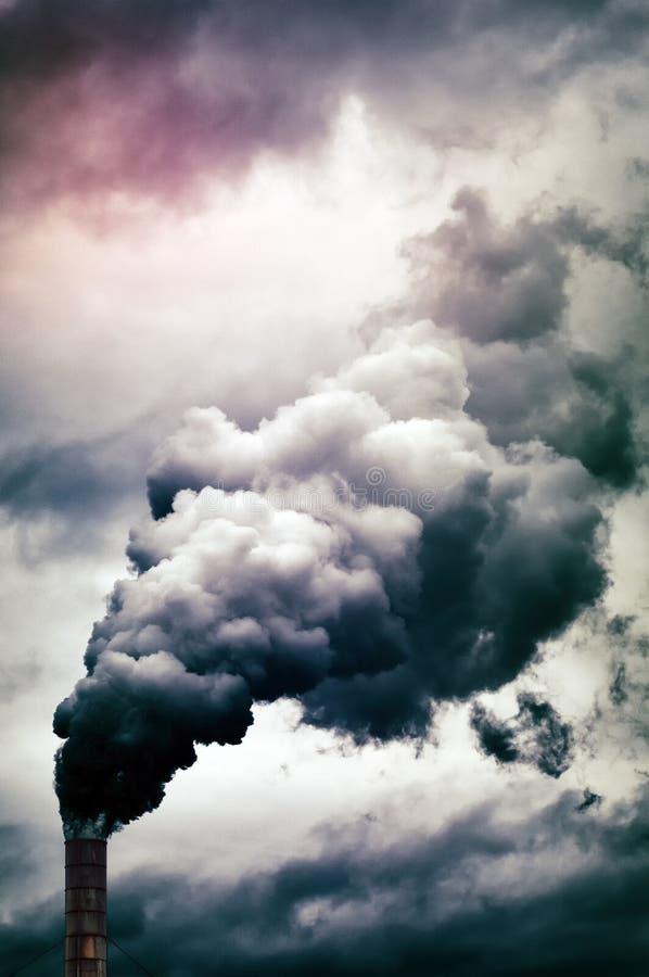 Factory smoke emission. Dense smoke emission from factory pipe stock image