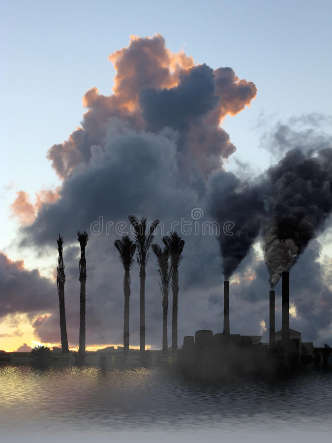 Factory Smoke Vs Folded Palm Stock Photo
