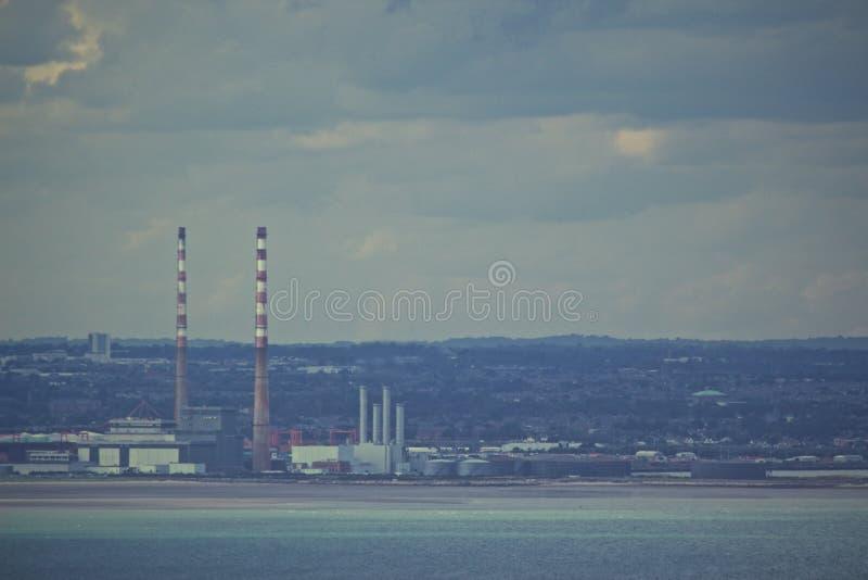 Factory smokestacks on horizon stock image
