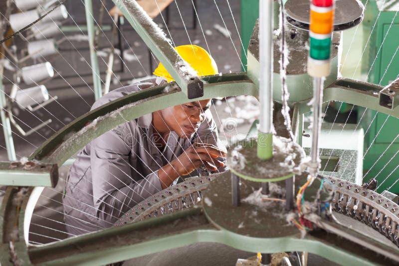 Factory technician repairing stock images