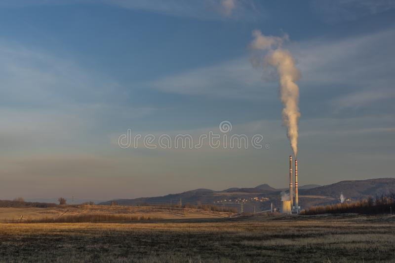 Factory in Usti nad Labem city from Milada lake in winter evening stock images