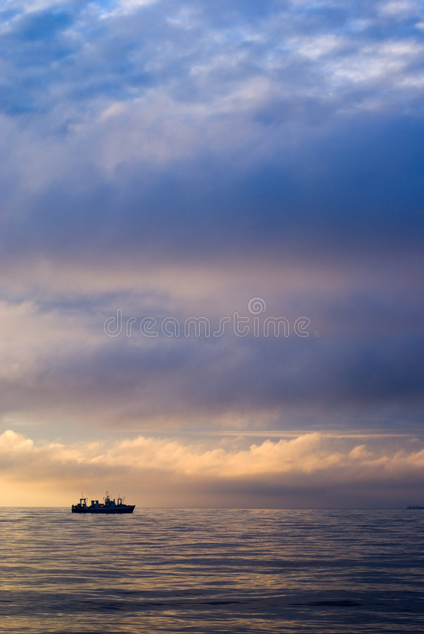Factory vessel and sunset royalty free stock photos