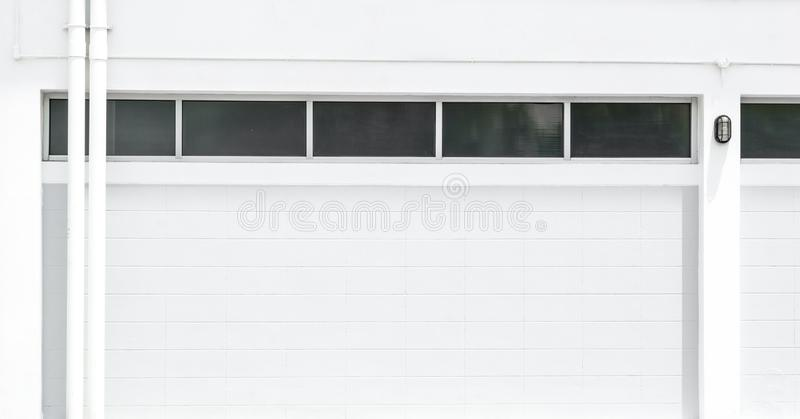 Concrete block wall and gutter of Factory or warehouse building in industrial estate and copy space. Factory warehouse and industrial concept - white concrete royalty free stock image