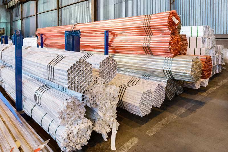 Factory warehouse metal rolled. Bundles of steel pipes stacked royalty free stock image
