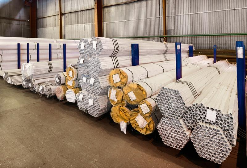 Factory warehouse metal rolled. Bundles of steel pipes stacked stock images