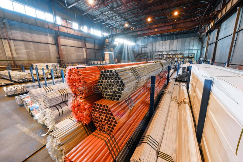 Factory warehouse metal rolled. Bundles of steel pipes stacked royalty free stock images