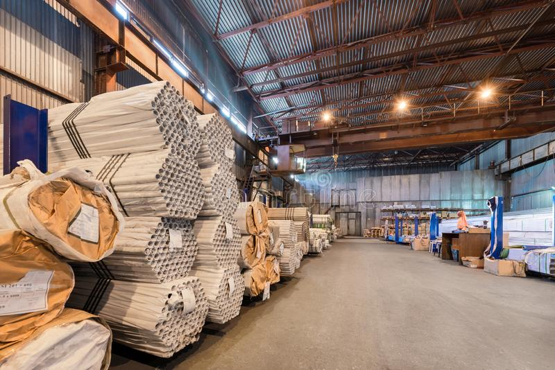 Factory warehouse metal rolled. Bundles of steel pipes stacked stock image