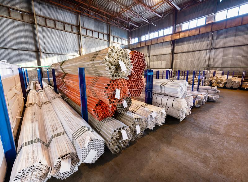 Factory warehouse metal rolled. Bundles of steel pipes stacked royalty free stock photos