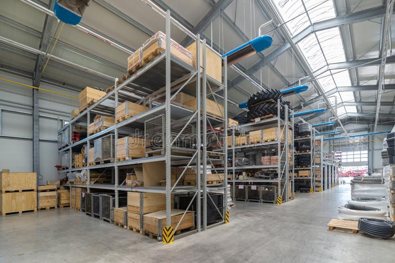 Factory warehouse spare parts. Storage and distribution of components.  royalty free stock photo