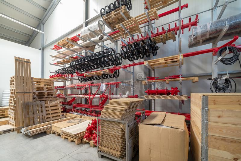 Factory warehouse spare parts. Storage and distribution of components.  royalty free stock photography