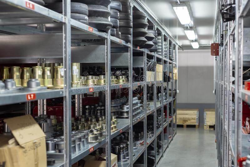 Factory warehouse spare parts. Storage and distribution of components.  royalty free stock images