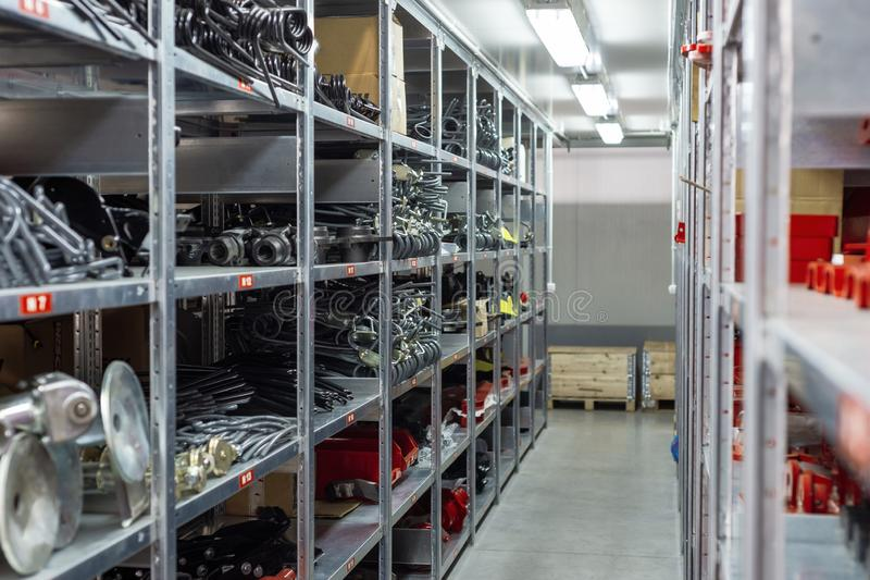Factory warehouse spare parts. Storage and distribution of components.  royalty free stock image