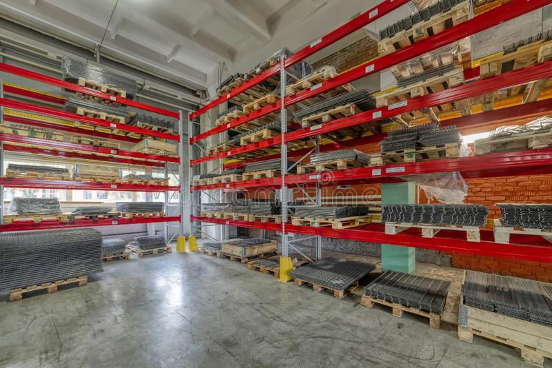 Factory warehouse steel reinforcement. High stacked shelving. stock photography
