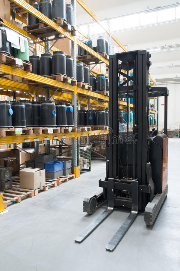 Factory wharehouse with forklift. Inside of factory wharehouse with forklift and goods stock photos