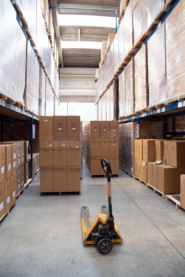 Factory wharehouse with forklift. Inside of factory wharehouse with forklift and goods stock photo
