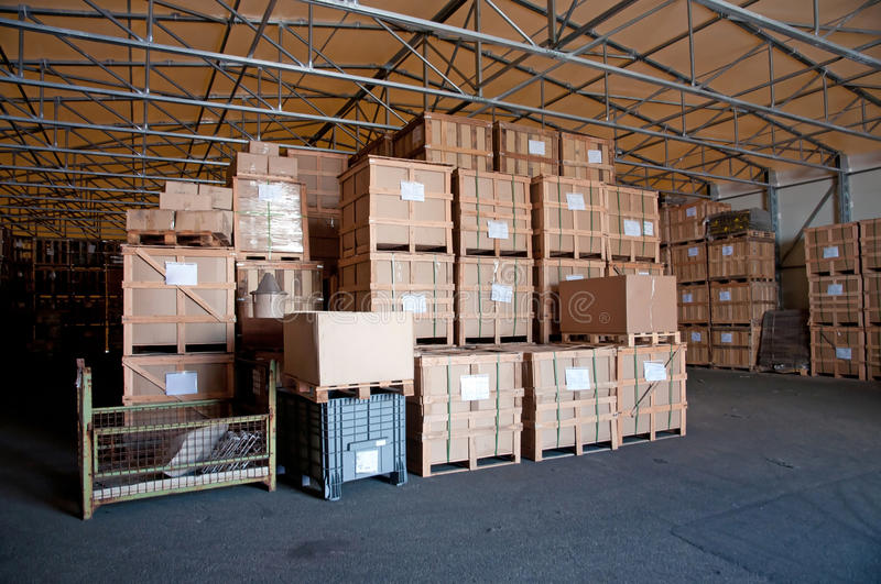 Factory wharehouse. Inside of factory wharehouse with goods royalty free stock photos