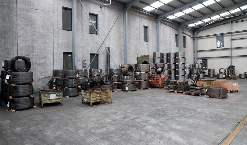 Factory wharehouse. Inside of factory wharehouse with goods stock images