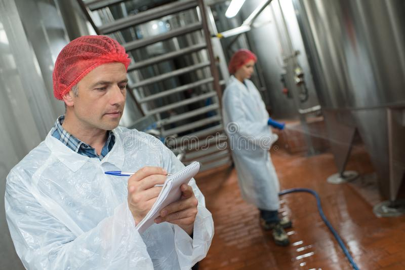 Factory worker cleaning floor stock photos