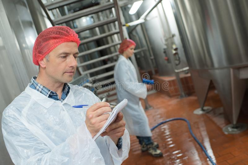 Factory worker cleaning floor. Cleaning royalty free stock photos