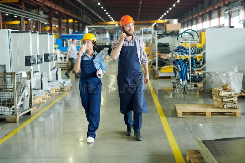 Factory Workers Crossing Hall stock photos