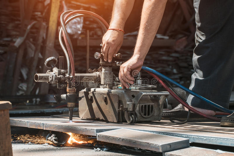 Factory workers cutting steel. 1 royalty free stock photography