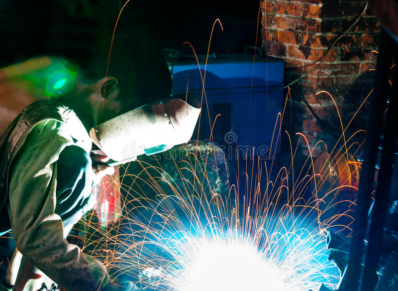 Factory workers in the steel structure welding stock photos