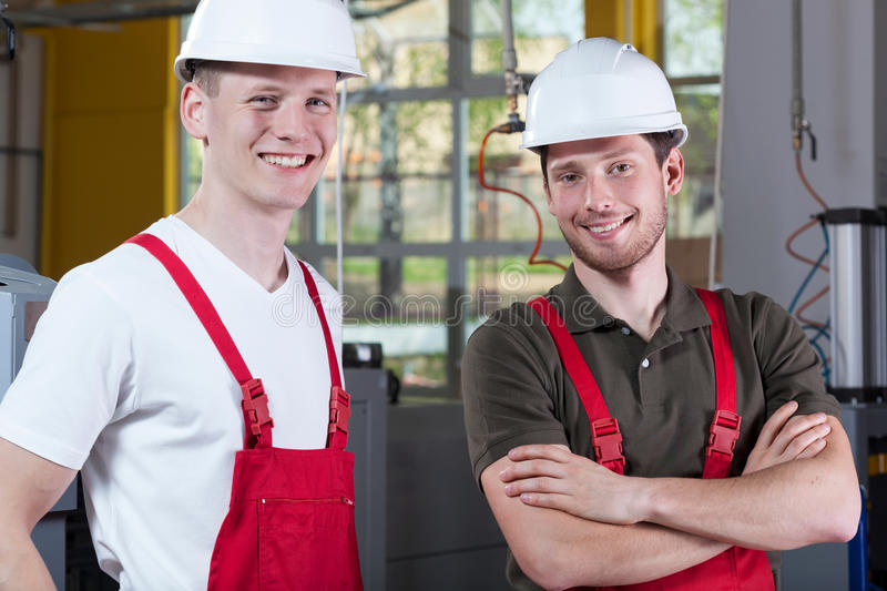 Factory workers taking a break of work. Horizontal royalty free stock photos