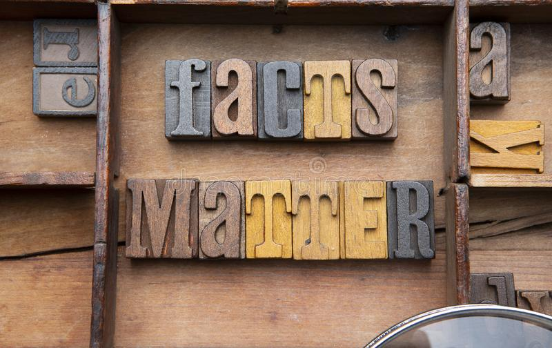 Fact Matter. Facts Matter Letters in wooden typeset letters on rustic background stock photography