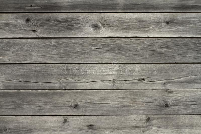 Faded age wooden boards. Old wooden floor, fence or wall. Weathered age boards, the result of carpentry work royalty free stock image