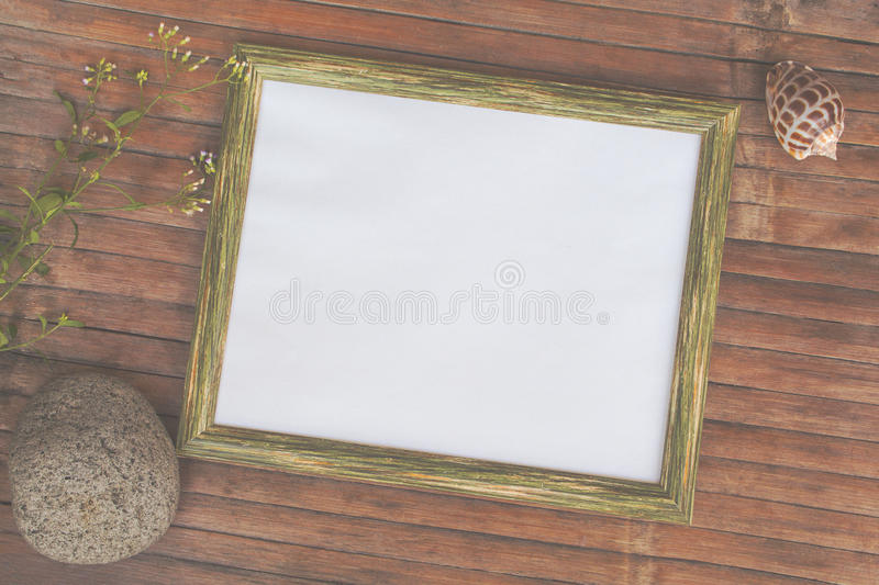 Faded flat lay with horizontal wooden frame with empty page. stock photos