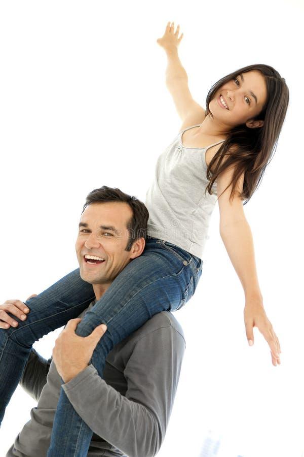 Fader och dotter som har gyckel arkivfoton