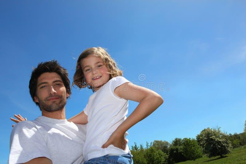 Fader- och dotterförbindelse arkivbild