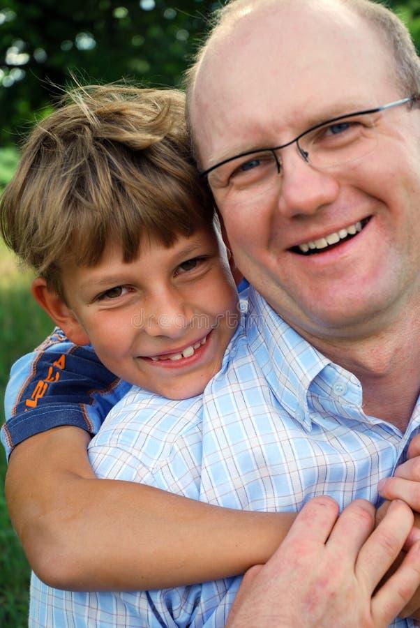 Fader och son royaltyfri bild