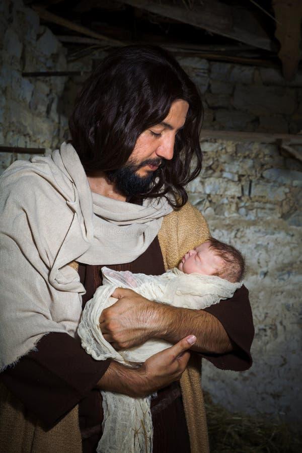 Fadern Joseph med behandla som ett barn Jesus royaltyfria foton