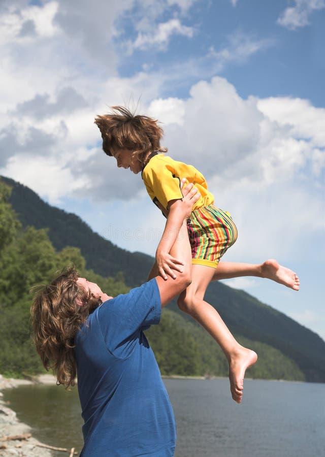 Download Faderson fotografering för bildbyråer. Bild av lake, bifokal - 984719