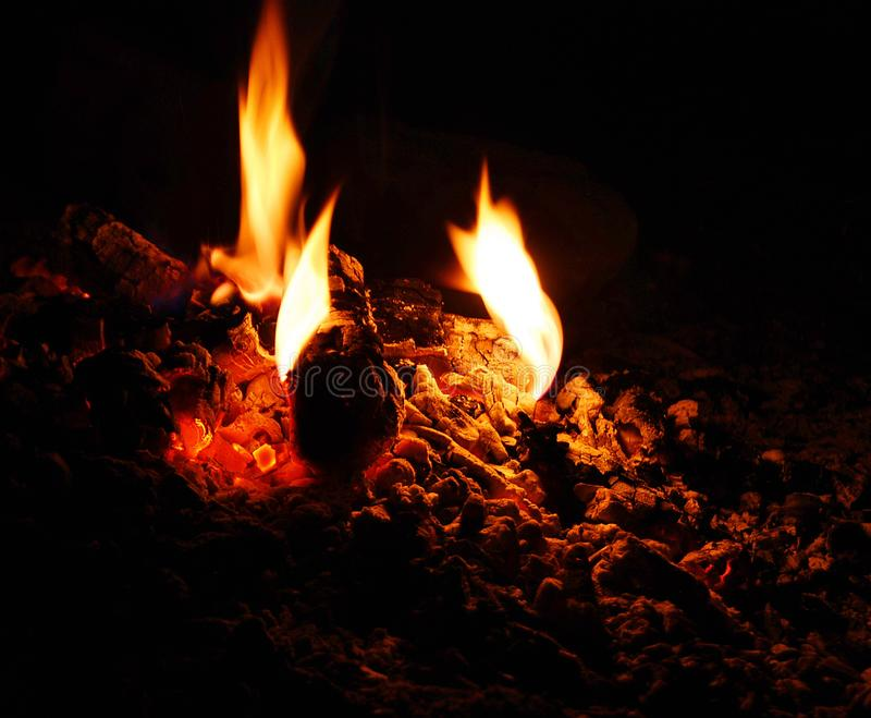 Fading campfire stock photography