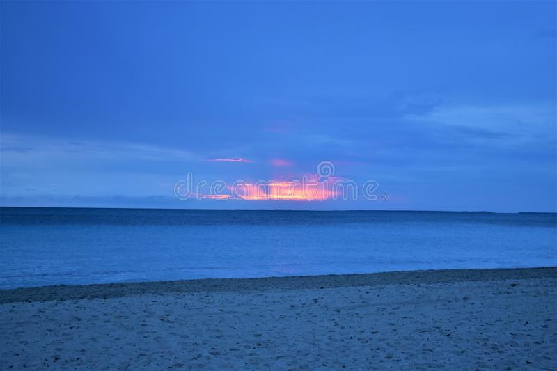 Beach, sand, water. Fading sunrise in one of the amazing beaches in Cuba royalty free stock image