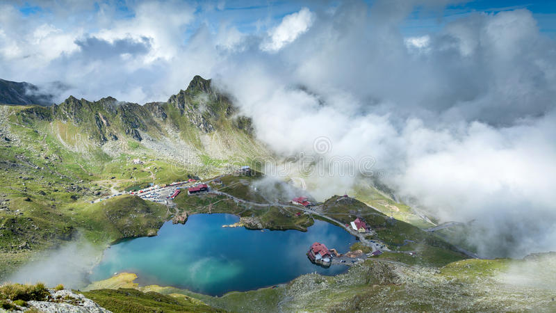 Fagaras Mountains, Romania. Transylvania region. Beautiful scenery with clouds, mountains and blue lake royalty free stock photo