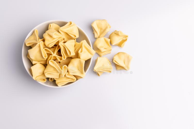 Fagottini Tortellini pasta in a white bowl isolated stock image