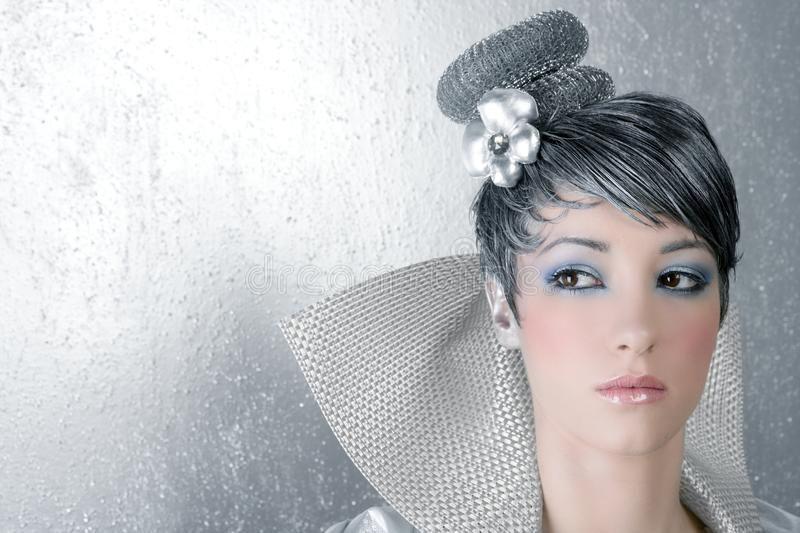 Fahion makeup hairstyle woman futuristic silver stock image