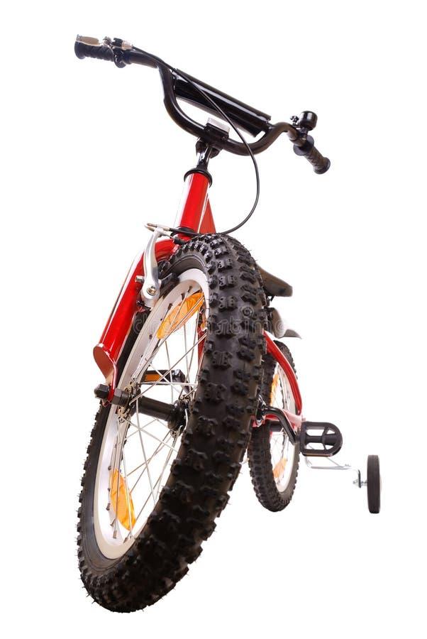 Fahrrad der neuen roten Kinder auf Weiß stockbild