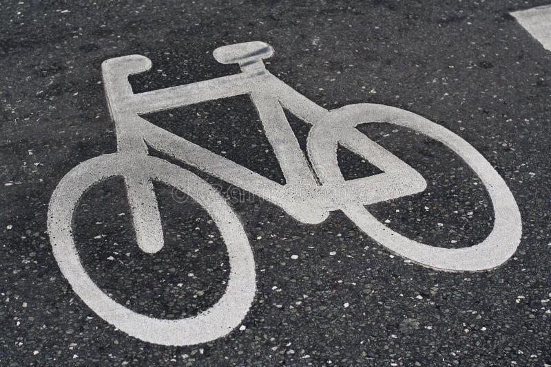 Fahrradzeichen auf der Straße stockfotos