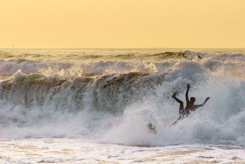 Fail. Clumsy surfer fail on water stock photos