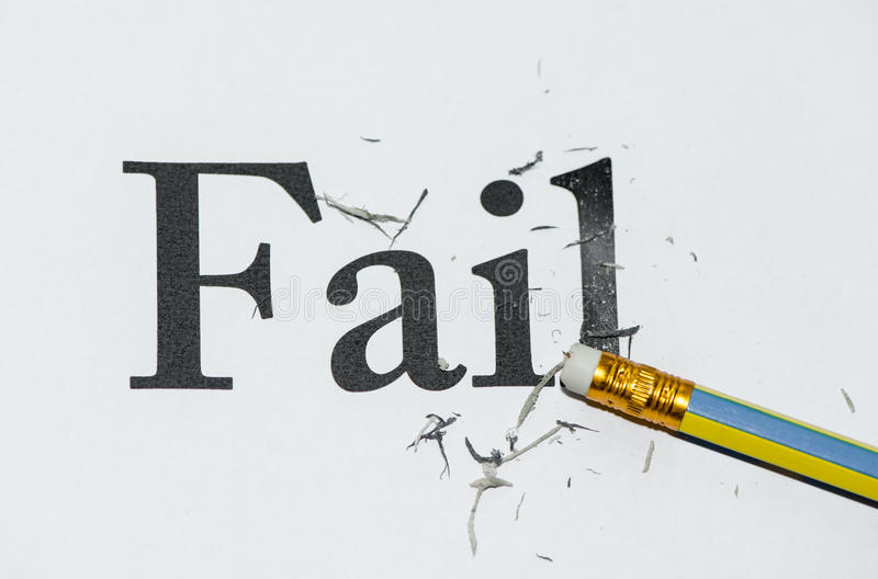 Fail. White paper was erasing by the pencil at the word fail royalty free stock photo